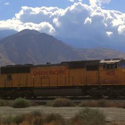 train closeup mountain peaks faraway